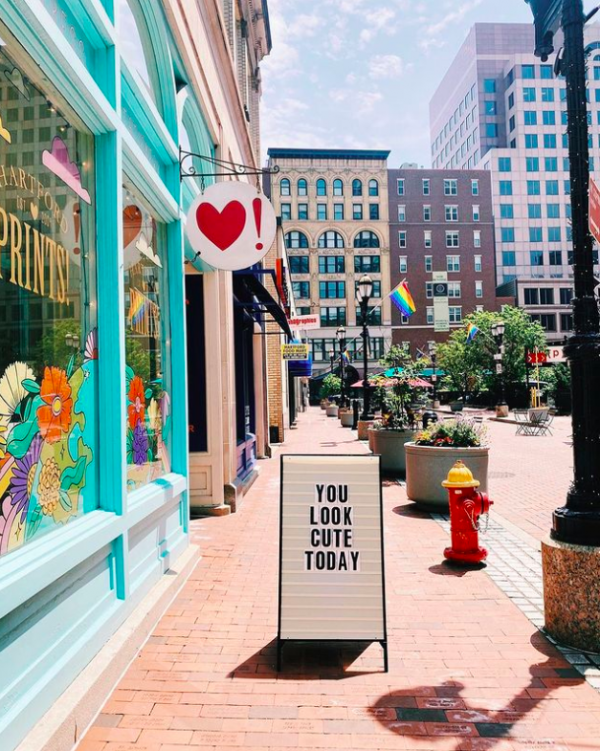 Front of Hartford Prints! Shop with a sandwich board street sign saying