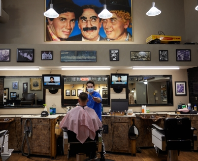 A man getting his hair cut at the Professional Barber Shop