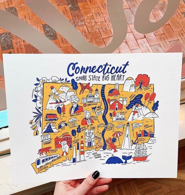 A hand holding a digitally illustrated image of Connecticut with creative icons.