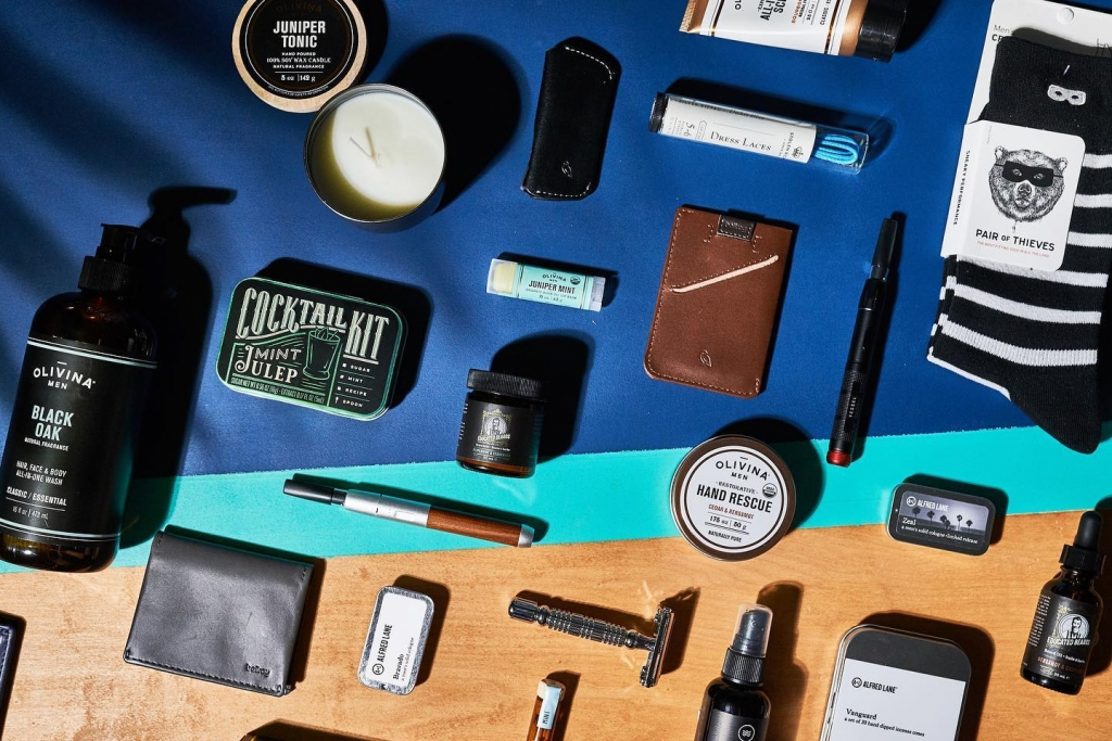 An overlay shot of mens lifestyle products such as wallets, shaving items, and socks.