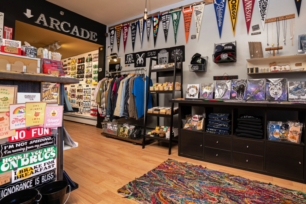 The inside of the Strange Ways store in New Haven with pendants, clothes, stickers and accessories.