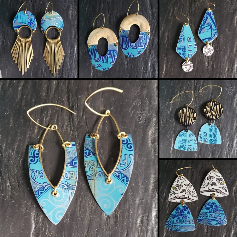 Six pairs of earrings that are shades of blue and gold.